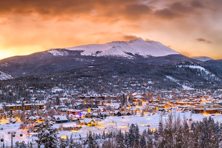 View of sunset over Rocky Mountains with the town of Breckenridge in the foreground