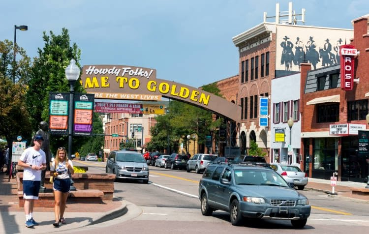 View of sign over street in downtown Golden Colorado
