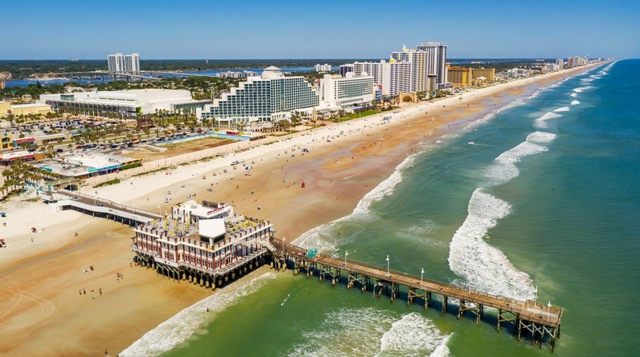 Aerial view of a pier and the residential area in Daytona Beach