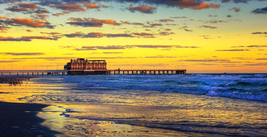 View of a pier from afar and the sunrise in Daytona Beach