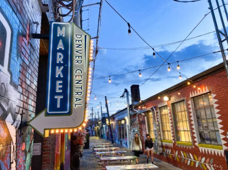 View of colorful alley artwork behind Denver Central Market