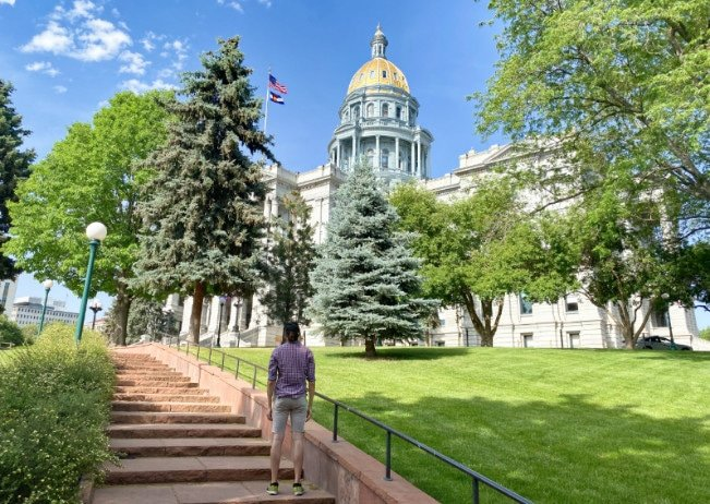 The author looking up at the outside of the Colorado State Capitol Building