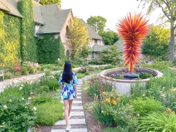 Woman walking among the Denver Botanic Gardens