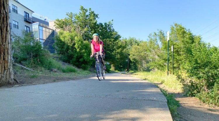 A biker on the Cherry Creek Trail