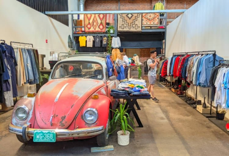 View of clothes and a VW beetle at Denver's The Source market hall