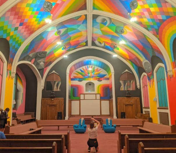 View of the interior of the colorful International Church of Cannabis Denver