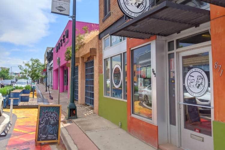 Colorful buildings along the sidewalk of Santa Fe Drive in Denver