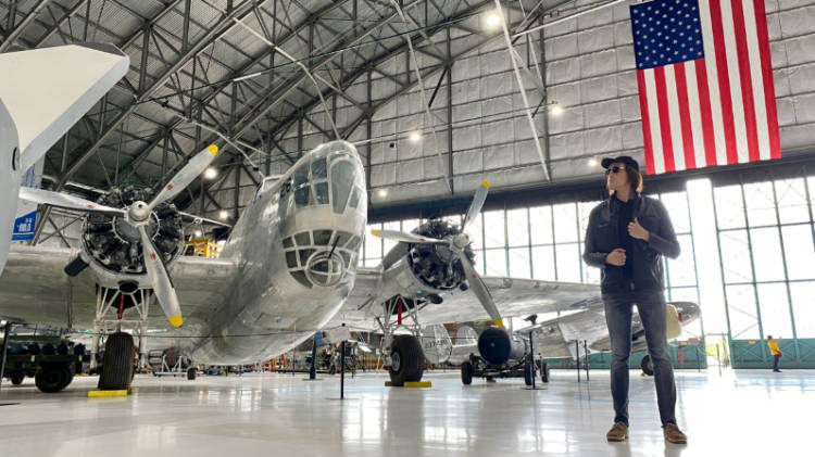 Nate looking at a plane in a hangar at the Wings Over the Rockies Museum