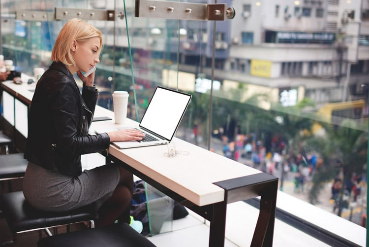 blonde woman on phone with laptop