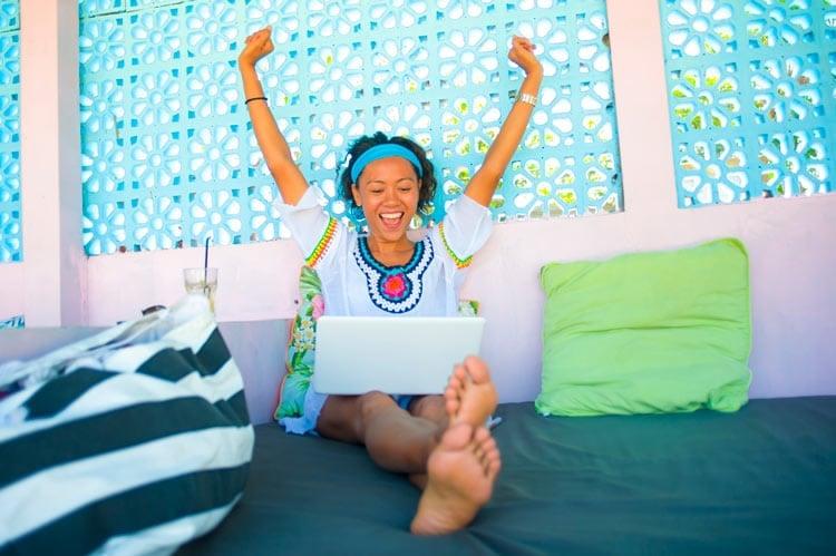 Happy woman look at remote job websites