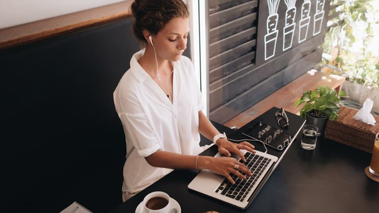 Woman working on laptop remotely