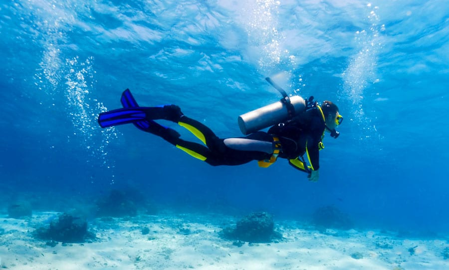 View of a scuba diver at the bottom of the sea