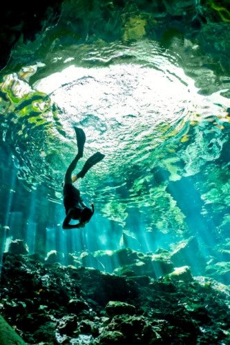 A diver in an underwater spring
