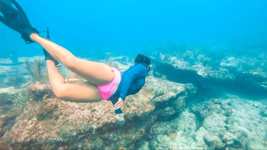 A woman dives near Key Largo