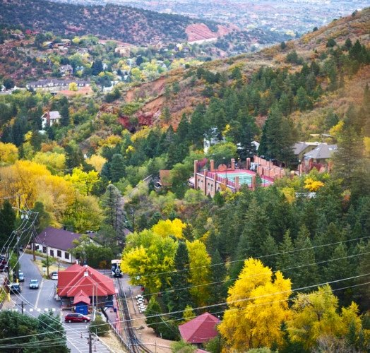 View of downtown Manitou Springs, Colorado with changing Aspen leaves