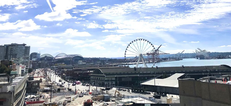 View of Downtown Seattle with a clear blue sky and the Seattle Great Wheel from afar