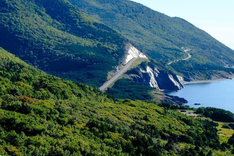 The Cabot Trail highway winds along steep cliffs overlooking the sea in Nova Scotia, Canada