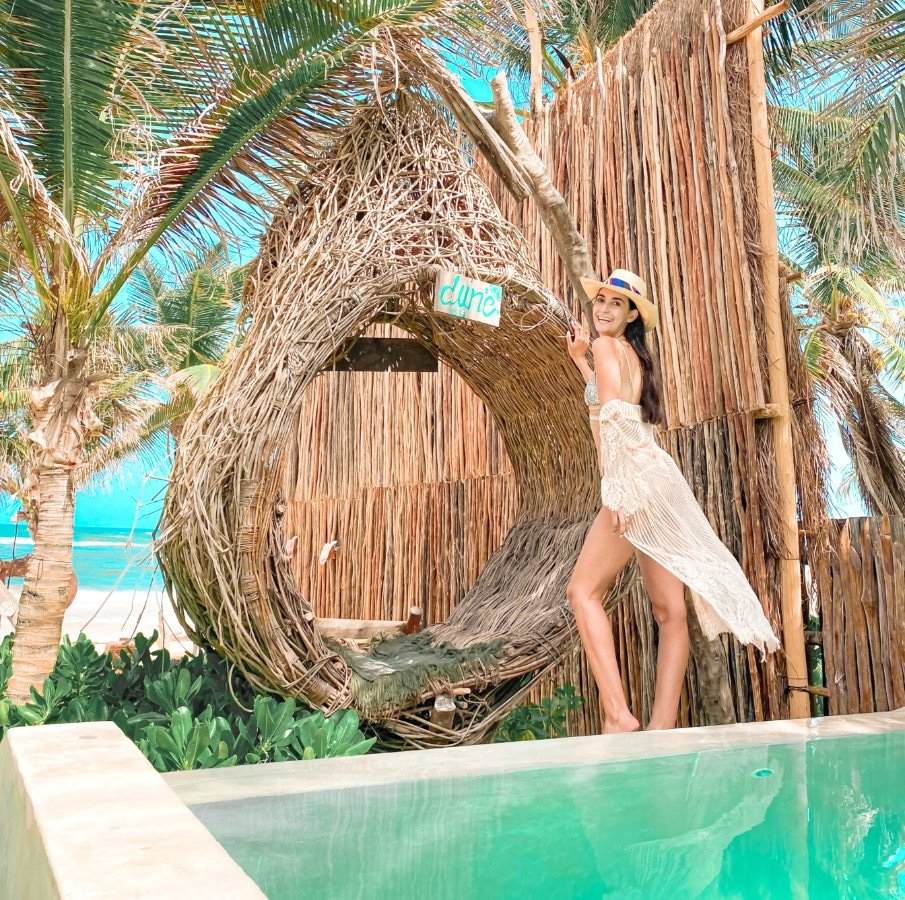 Woman standing in front a pool near Tulum beach area