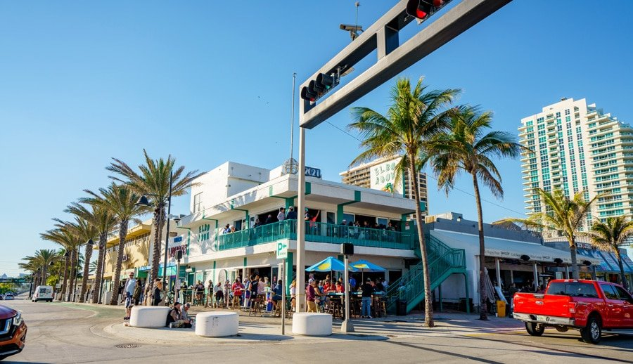 View of a beach bar Elbo Room in a busy corner of Las Olas Blvd and Ocean Drive