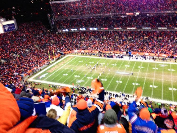 Crowds cheering at Broncos stadium