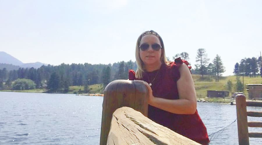 View of the author and the Evergreen Lake on her background