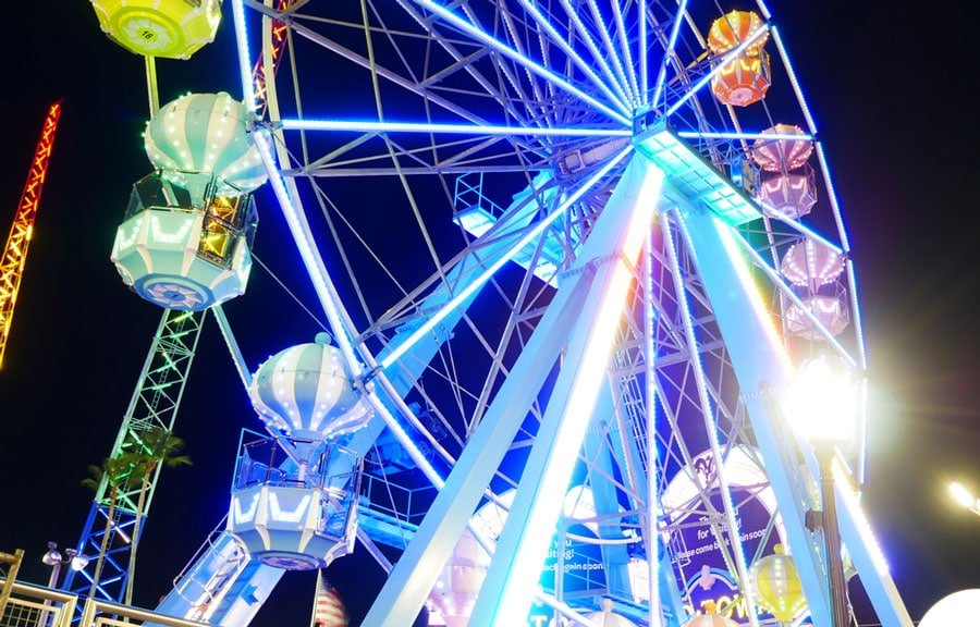 View of a colorful ferris wheel at night