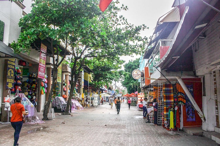 5th Avenue in Playa del Carmen shortly after a rain, with shops lining the streets.