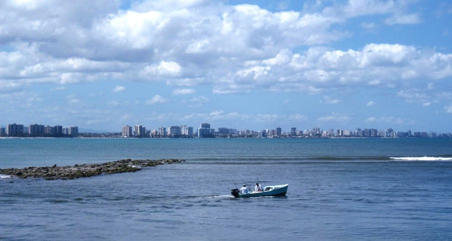 View of two people enjoying themselves while fishing off the coast of Lajas.