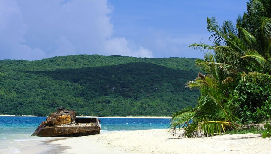 View of the Flamenco Beach and the old tank by the shore