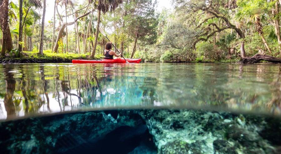 View of a woman kayaking in 7 Sisters Springs