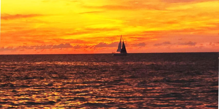 View of a sailing boat in Fort Myers during sunset