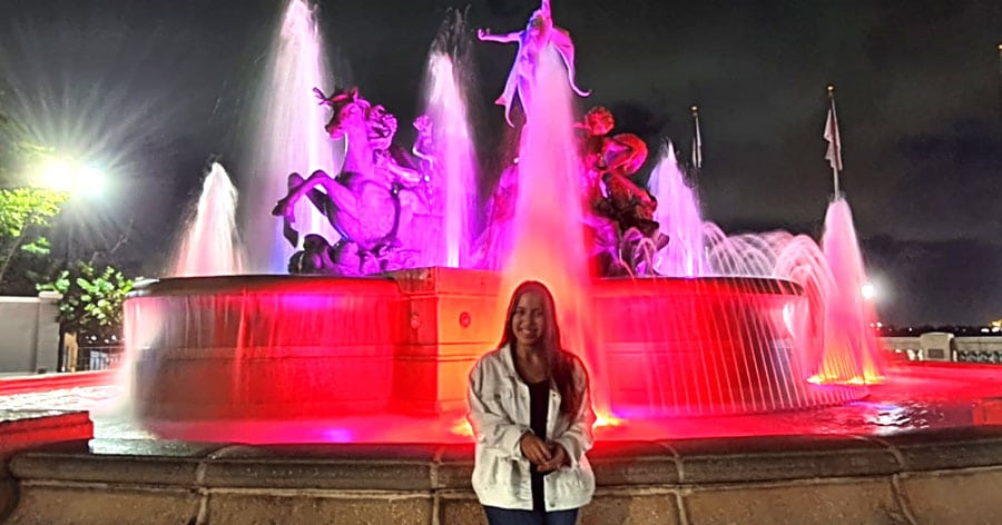 The author a colorful water fountain on her background