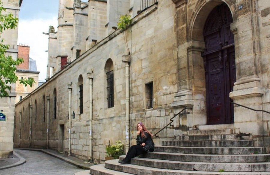 View of the author in front of a church in France