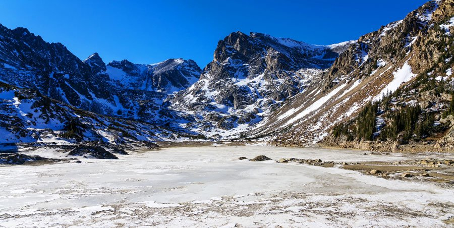 View of the frozen Brainard lake in the wilderness