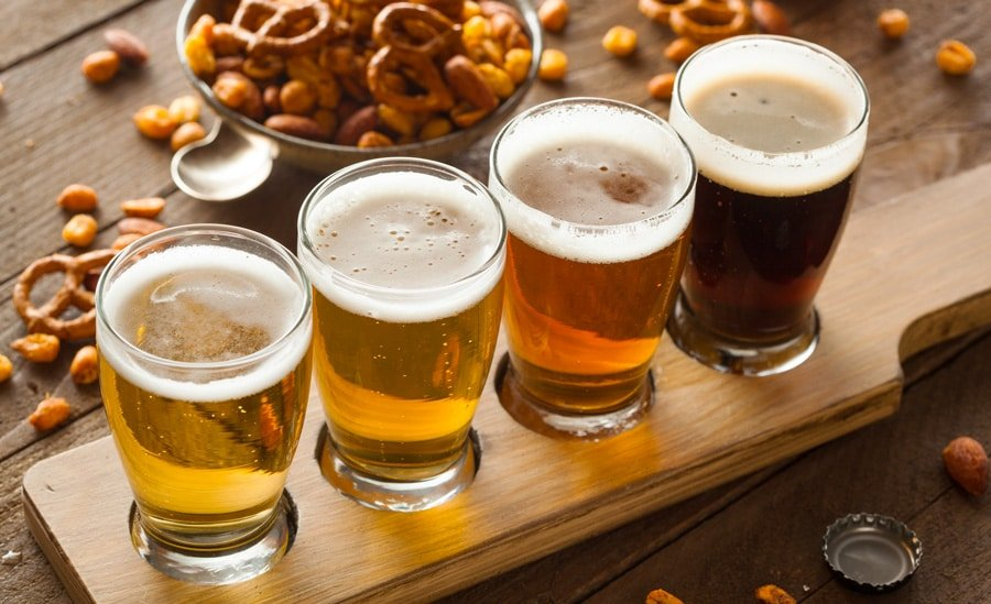 View of assorted beers in a flight ready for tasting