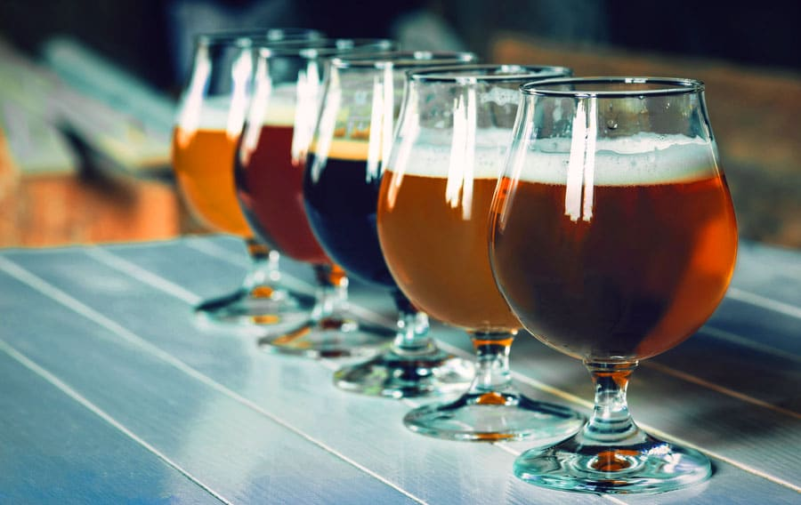 View of different beers on a wooden table