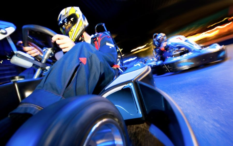 View of two go kart drivers at night