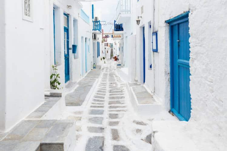 Whitewashed footpath between houses in Mykonos Greece