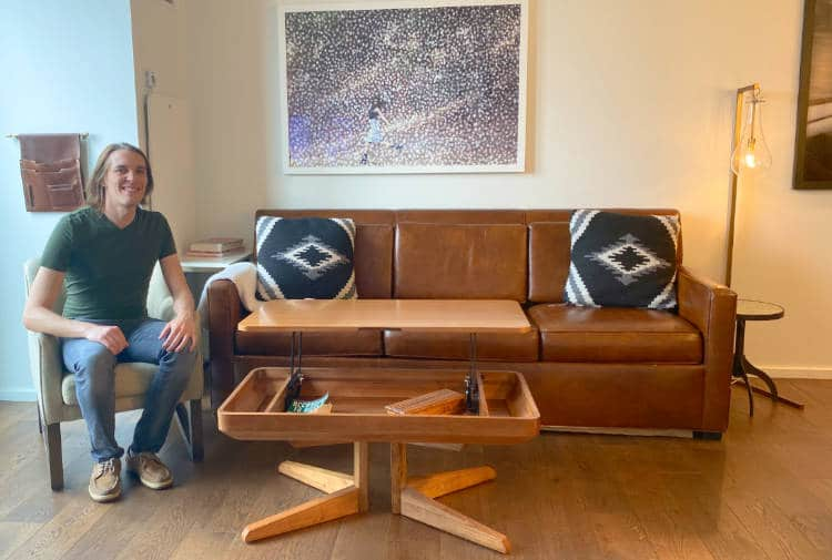 The author sitting in a living room of a suite at the Halcyon Hotel in Cherry Creek, Denver