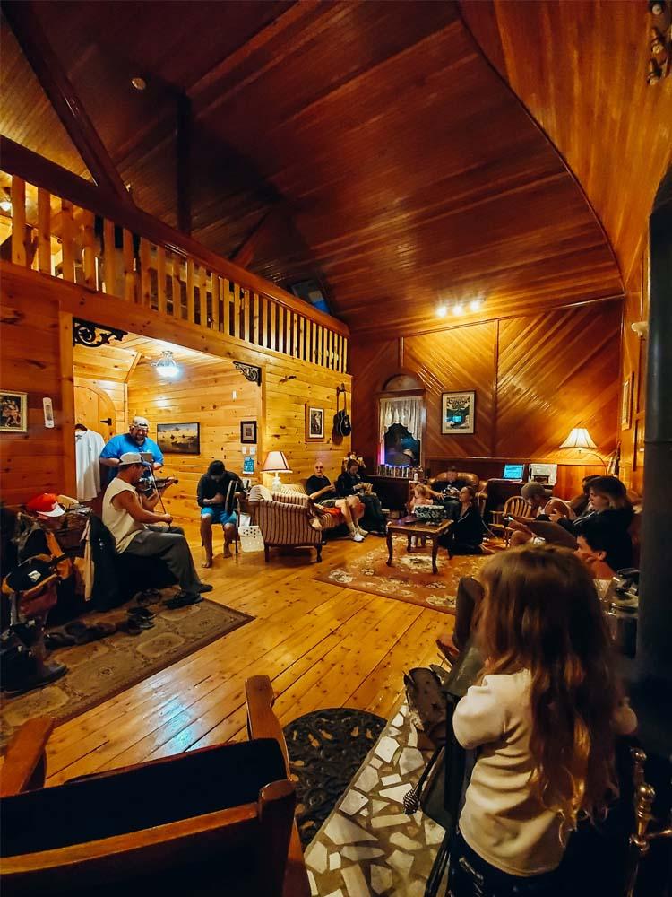 people inside Highlands Hostel at Cabot Trail