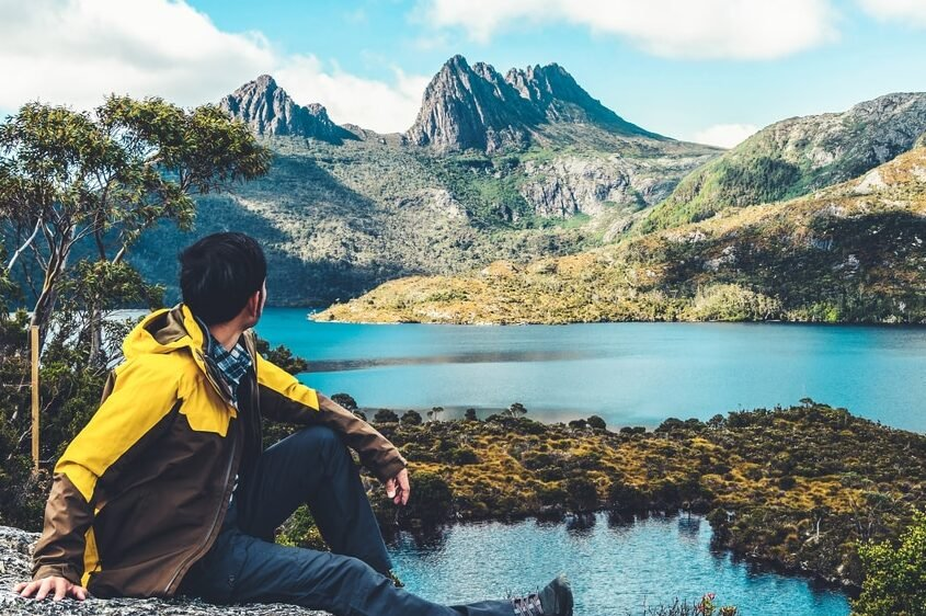 A hiker looking at Cradle Mountain