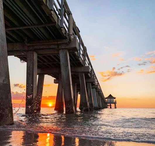 The Naples Pier and the colorful sky during sunset