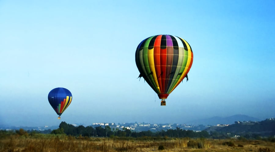 View of hot air balloons floating high above in Del Mar
