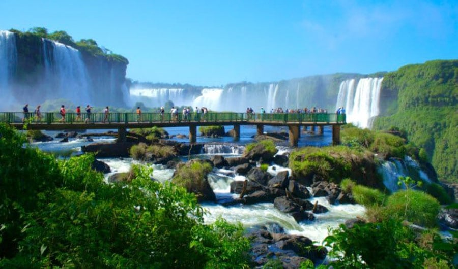 View of people having a tour in Iguazu Falls
