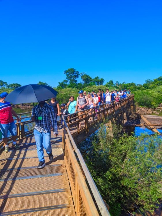 People on gangway to Devil's Throat in Iguazu Falls Argentina