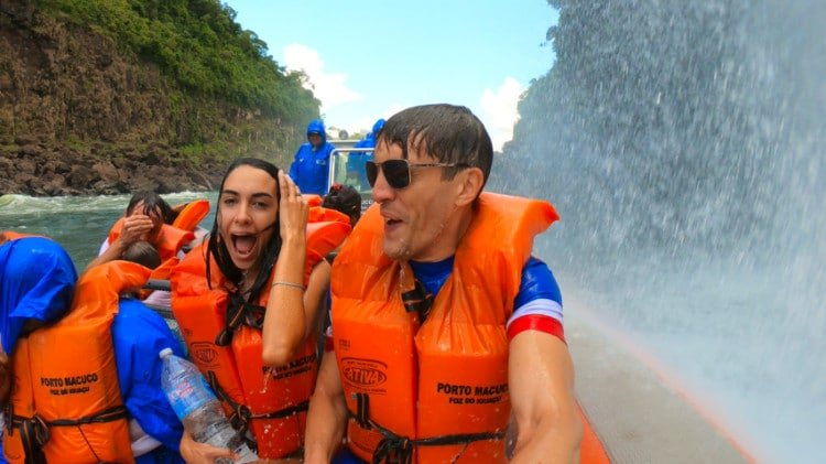Water splashing over boat in Iguazu Brazil
