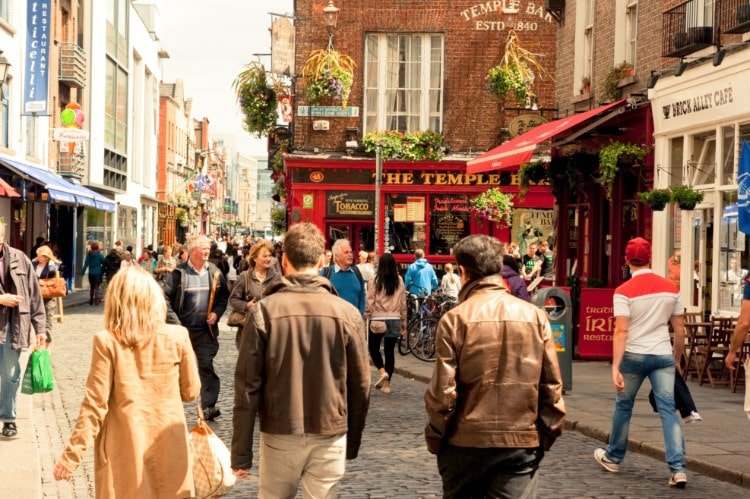 People walking past Temple Bar in Dublin Ireland