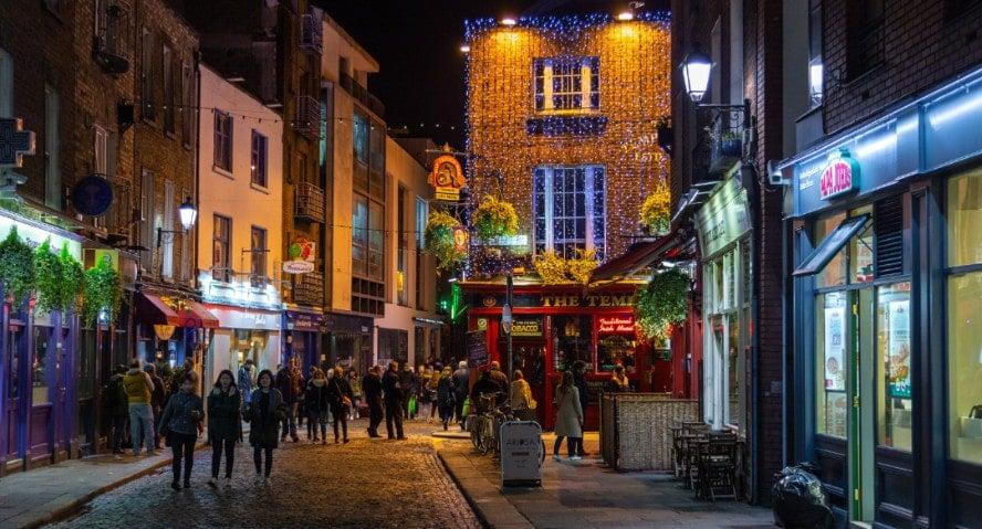 People walking on a street in Dublin at night