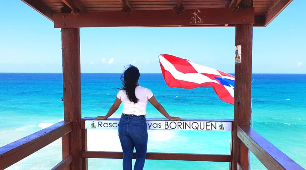 The author observing the calm blue sea in Puerto Rico