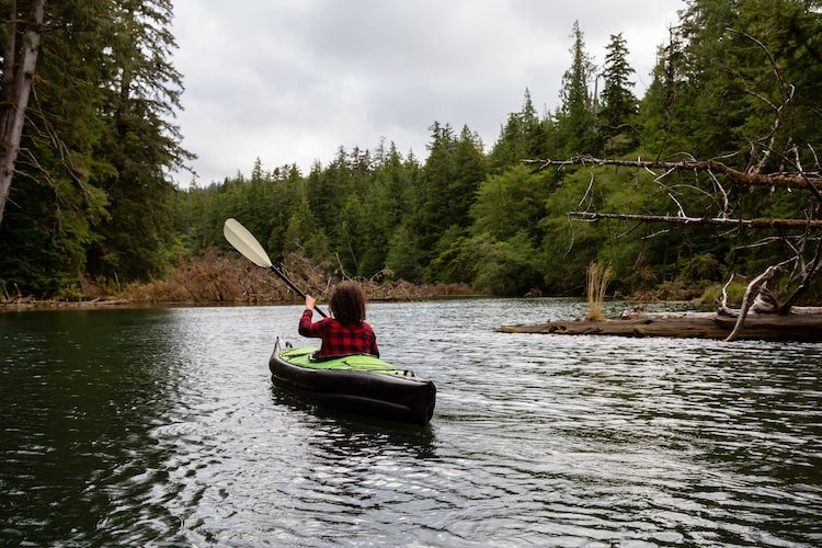 A woman kayaks on Vancouver Island, Canada